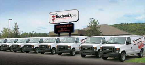 A row of trucks representing vehicles used by mold treatment company Bactronix in Moon, PA